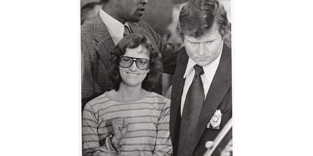 Patty Hearst being moved after arrest.