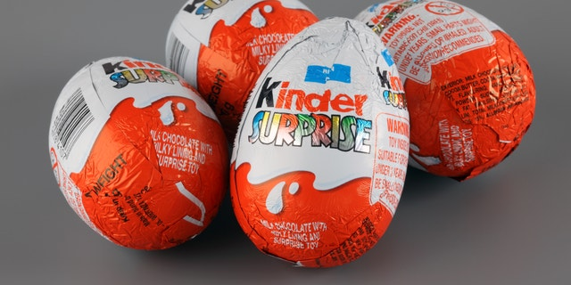 """Tambov, Russian Federation - April 04, 2013: Four Kinder Surprise Eggs on grey background. Kinder Surprise manufactured by Italian company Ferrero. Studio Shot. Each Kinder Surprise egg consists of a chocolate shell, a plastic capsule, the contents of said capsule, and an external foil wrap."""