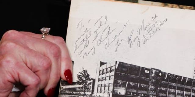 """Beverly Nelson shows reporters her high school yearbook on Nov. 13, which she says Roy Moore signed: """"To a sweeter more beautiful girl I could not say 'Merry Christmas.'"""""""