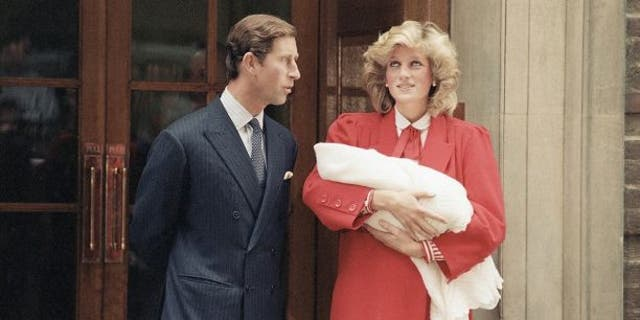 Princess Diana and Prince Charles leave St. Mary's Hospital in London with Prince Harry on Sept. 16, 1984.