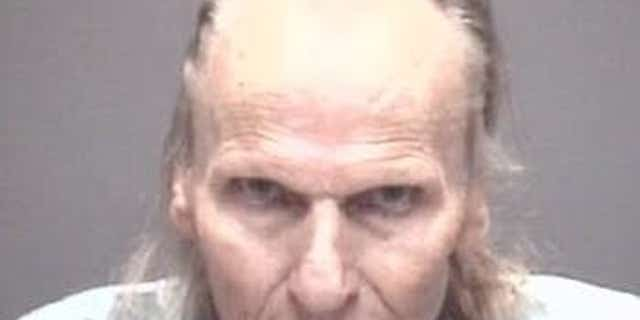 Johnny Manning, 72, was arrested after allegedly using a lawnmower to hurl rocks at three people, police said.