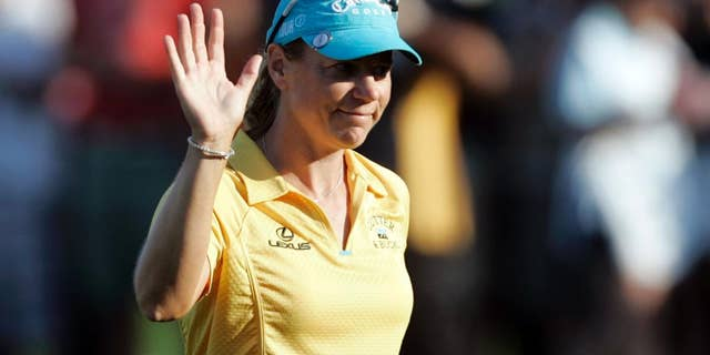 FILE- In this Dec. 14, 2008, file photo, Sweden's Annika Sorenstam waves to supporters following the end of the final round of the Dubai Ladies Masters golf tournament in Dubai, United Arab Emirates. Sorenstam will captain the European Solheim Cup team next year in Des Moines, Iowa, the Ladies European Tour announced, Wednesday, March 30, 2016. (AP Photo/Kamran Jebreili, File)