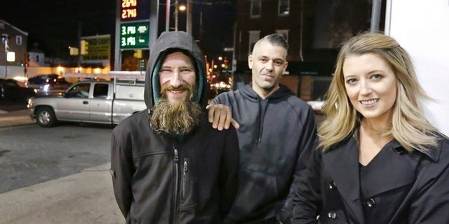 Mark D'Amico, 39, (center) was indicted on six separate charges related to the alleged 2017 scheme involving his then-girlfriend, Katelyn McClure, and homeless veteran Johnny Bobbitt (left).