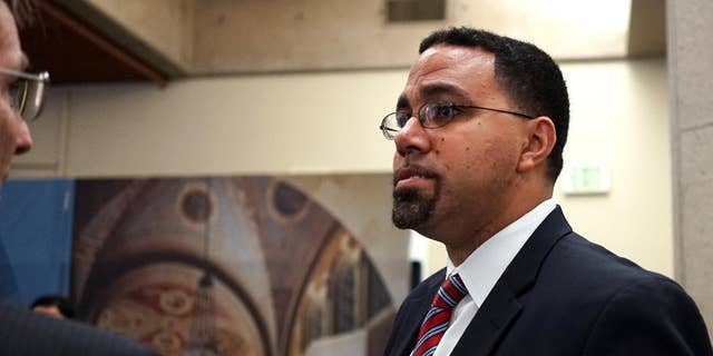 """U.S. Education Secretary John King meets with students and administrators at the University of California, Los Angeles on Monday, May 9, 2016. The Common Application used for college admissions at more than 600 institutions is changing a question is asks about student criminal records, as the U.S. Department of Education urges schools to consider dropping the question altogether. King called it """"an important step forward."""" (AP Photo/Christine Armario)"""