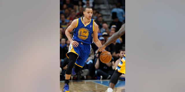 Golden State Warriors guard Stephen Curry picks up a loose ball against the Denver Nuggets in the first quarter of Game 2 of the teams' NBA first-round playoff series in Denver on Tuesday, April 23, 2013. (AP Photo/David Zalubowski)