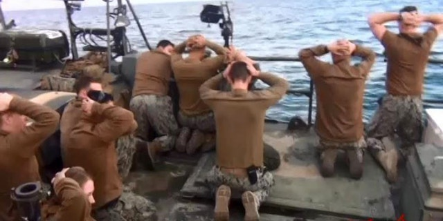 This picture released by the Iranian state-run IRIB News Agency shows the detention of U.S. Navy sailors in January.