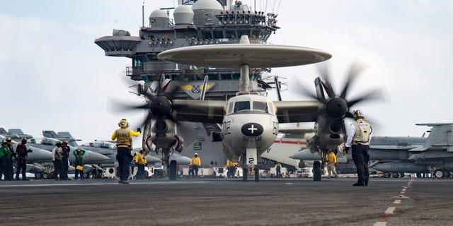 An E2-C Hawkeye on the flight deck of the aircraft carrier USS Dwight D. Eisenhower on June 28, 2016.