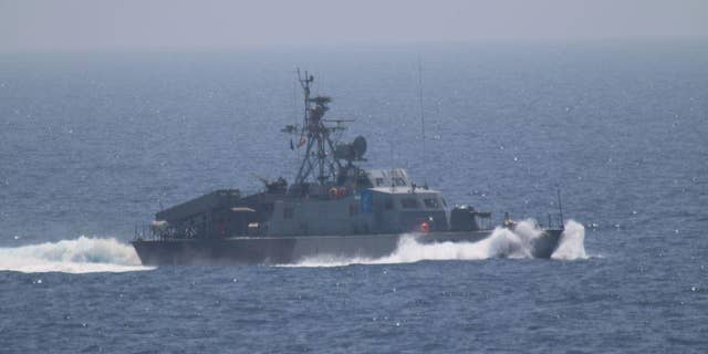 Iran's Houdong-class missile boat seen from the USS New Orleans.