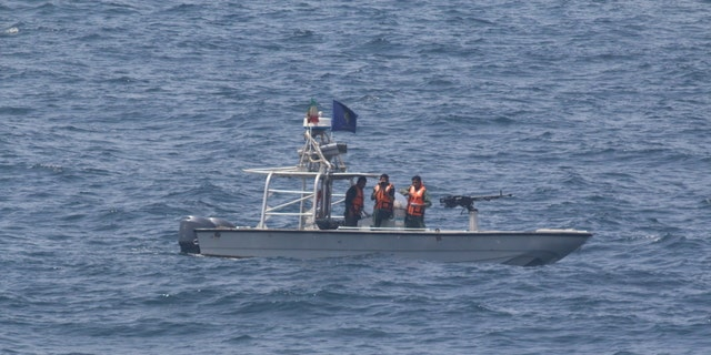 An Iranian patrol boat seen from the USS New Orleans.