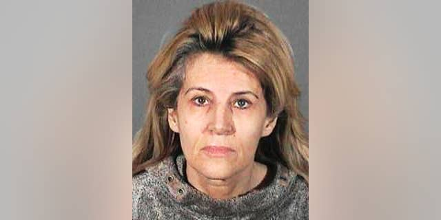 """This undated handout booking photo from the Los Angeles County Sheriff shows Dawn DaLuise.  DaLuise, 55, was arrested after authorities say she tried to hire someone to kill a business rival she mistakenly thought was behind a cyber-stalking campaign, which included lewd flyers, emails and Craigslist ads with her address seeking men to act out a """"rape fantasy."""" Authorities recently arrested a suspect in the case, which was not the man she sought to have killed. (AP Photo/Los Angeles County Sheriff)"""