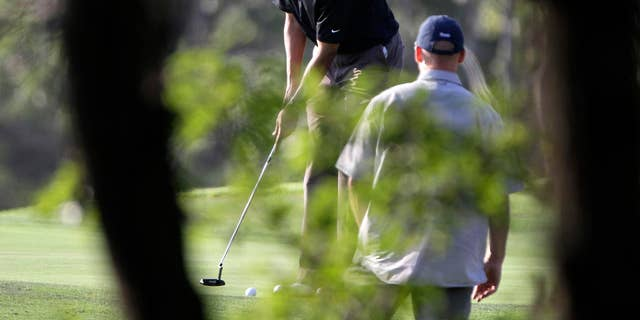 Friday: President Obama prepares to putt while playing golf at the Vineyard Golf Club, in Edgartown, Mass., on the island of Martha's Vineyard. The president is vacationing on the island with his family. (AP Photo)