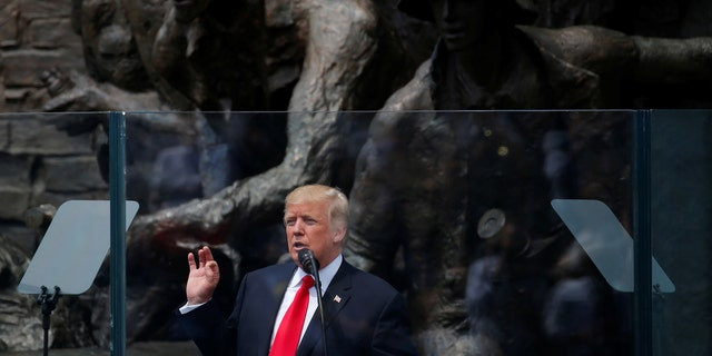 U.S. President Donald Trump gestures during his public speech in front of the Warsaw Uprising Monument at Krasinski Square, in Warsaw, Poland July 6, 2017. REUTERS/Laszlo Balogh - RTX3AA2I