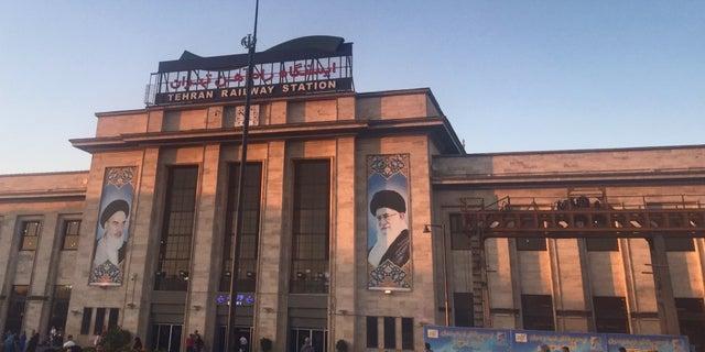 Portraits of Iran's Supreme Leaders, the late Khomeini and his predecessor Khamenei, adorn landmarks across Iran.