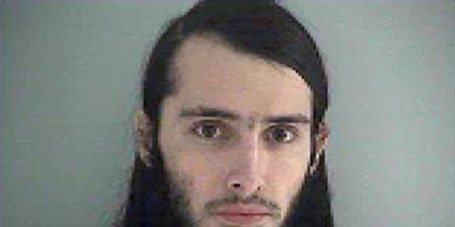 """FILE - This Wednesday Jan. 14, 2015 file photo made available by the Butler County Jail shows Christopher Lee Cornell. U.S. District Judge Sandra Beckwith agreed Wednesday, April 1, 2015, to push back deadlines in the """"unusual and complex"""" case of of Christopher Lee Cornell, an Ohio man accused of plotting to attack the U.S. Capitol. Beckwith postponed pretrial filing deadlines from April 10 to May 29 in the case of Cornell. Federal prosecutors had requested the delay, and Cornell?'s attorneys did not object.  (AP Photo/Butler County Jail, File)"""