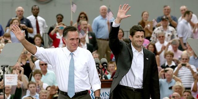 NORFOLK, VA - AUGUST 11:  Republican presidential candidate, former Massachusetts Gov. Mitt Romney (L) announces Rep. Paul Ryan (R-WI) (R) as his running mate in front of the USS Wisconsin August 11, 2012 in Norfolk, Virginia. Ryan, a seven term congressman, is Chairman of the House Budget Committee and provides a strong contrast to the Obama administration on fiscal policy.  (Photo by Win McNamee/Getty Images)