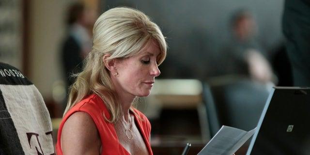 Texas Sen. Wendy Davis sits at her desk. Erich Schlegel/Getty Images.