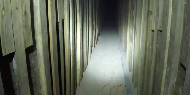Video showed the tunnel walls lined with wooden planks.