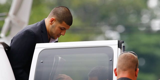 Aaron Hernandez is escorted into Attleboro District Court on August 22, 2013 in North Attleboro, Massachusetts.