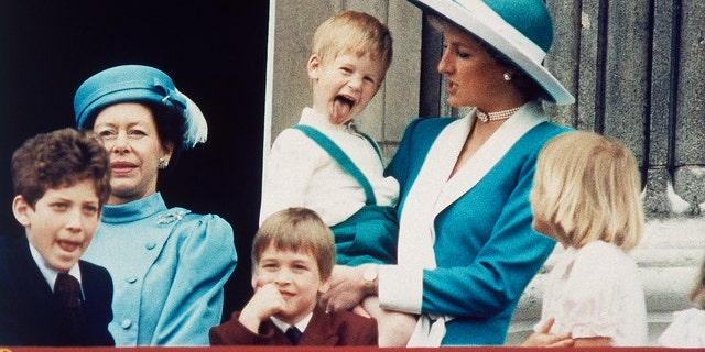 In this June 11, 1988 file photo, Britain's Prince Harry sticks out his tongue for the cameras on the balcony of Buckingham Palace in London.