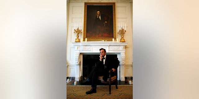 Actor Fritz Klein of Springfield, Illinois poses in the State Dining Room under a painting of President Abraham Lincoln as part of the haunted White House Halloween tours in Washington, October 28, 2016.
