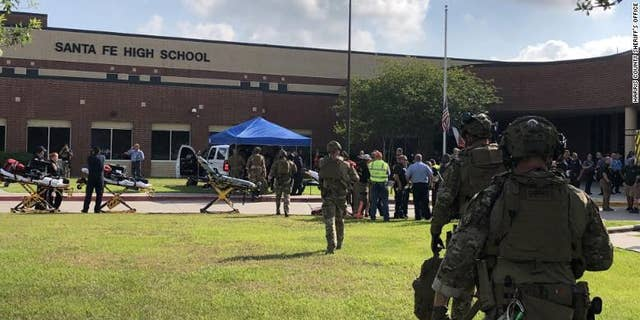 Law enforcement officers respond to Santa Fe High School following a shooting incident in this Harris County Sheriff office, Santa Fe, Texas, U.S., photo released on May 18, 2018.