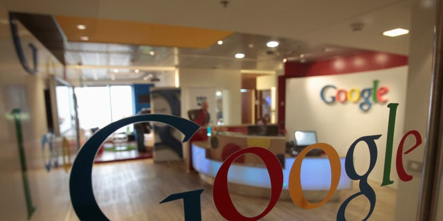 The Google logo is seen on a door at the company's office in Tel Aviv January 26, 2011.