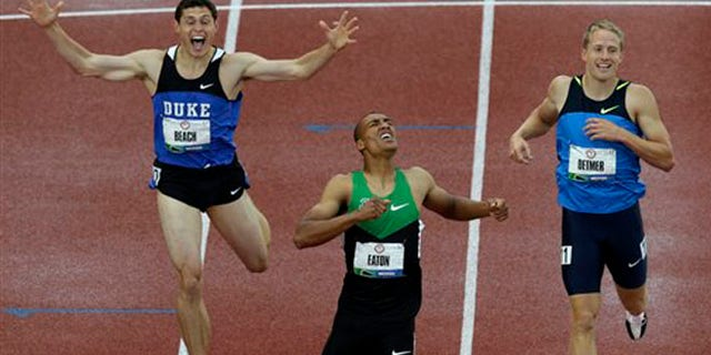 June 23, 2012: Ashton Eaton reacts with Curtis Beach and Joe Detmer after the 1500m during the decathlon competition at the U.S. Olympic Track and Field Trials in Eugene, Ore.
