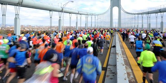 Runners cross the Verrazano-Narrows Bridge at the start of the ING New York City Marathon, Nov. 3, 2013.