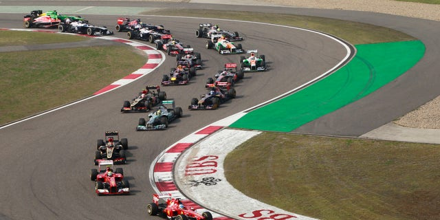 Mercedes driver Lewis Hamilton of Britain  leads the field into turn three at the start of  the Chinese Formula One Grand Prix in Shanghai, China, Sunday, April 14, 2013.  (AP Photo/Eugene Hoshiko)