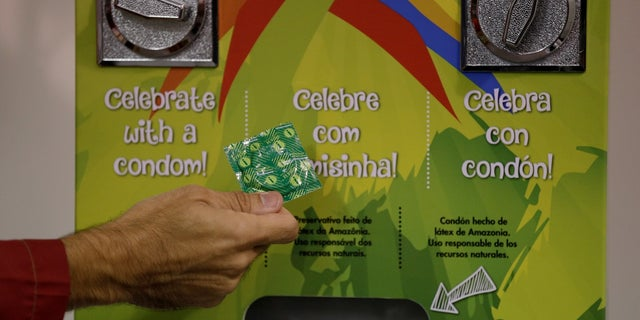 A condom dispenser is seen at the 2016 Rio Olympics Village in Rio de Janeiro. This year, a total of 110,000 condoms will be distributed at the Winter Olympics in South Korea, translating to about 37.6 contraceptives per athlete.