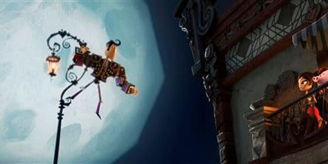 Manolo, left, voiced by Diego Luna, serenading Maria voiced by Zoe Saldana in a scene from 'Book of Life.'