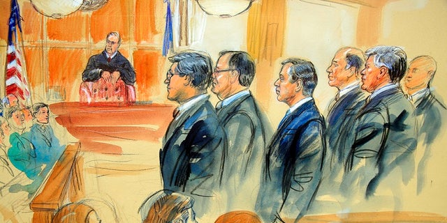 This courtroom sketch depicts Paul Manafort, fourth from right, standing with his lawyers in front of U.S. district Judge T.S. Ellis III, center rear, and the selected jury, seated left, during the jury selection of his trial at the Alexandria Federal Courthouse in Alexandria, Va., Tuesday, July 31, 2018.