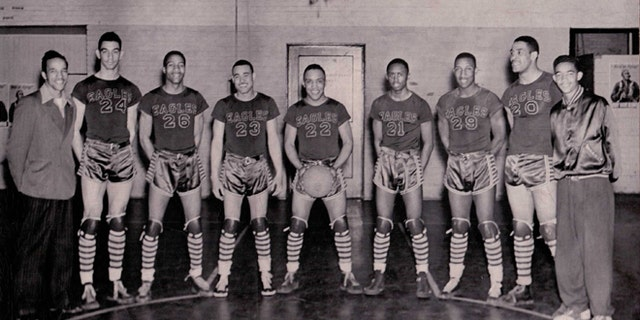 """The Durham News & Observer identified the players for the Eagles from the left as Coach John B. McLendon, George Parks, an unidentified player, Billy Williams, James Hardy, Aubrey 'Stinkey' Stanley, Floyd Brown, Henry 'Big Dog' Thomas and manager Edward """"Pee Wee"""" Boyd."""