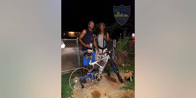 Jacksonville police officer Terrance Hightower bought two new bike tires for the man after seeing him ride down the street with only one functioning wheel. (Jacksonville Sheriff's Office)