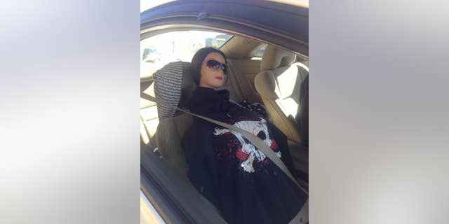 A man driving a mannequin disguised as a woman wearing a black hoodie with a skull was busted for driving in the carpool lane on a California highway. (CHP - Santa Rosa)