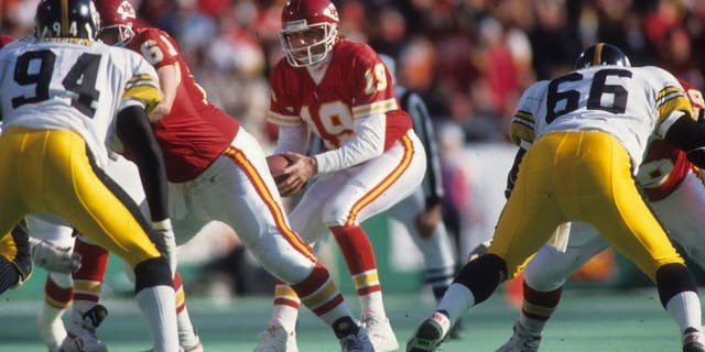 Kansas City Chiefs quarterback Joe Montana # 19 dropped to pass in the 1993 AFC Wild Card Game on January 8, 1994 against the Pittsburgh Steelers in Kansas City, Missouri.  The Chiefs beat the Steelers 27-24 in overtime.  (Photo by Joseph Patronite / Getty Image)