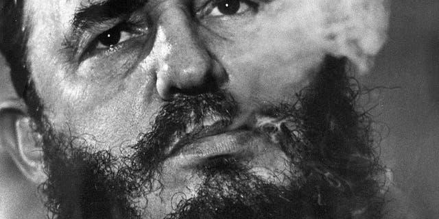 Cuba's leader Fidel Castro smokes a cigar