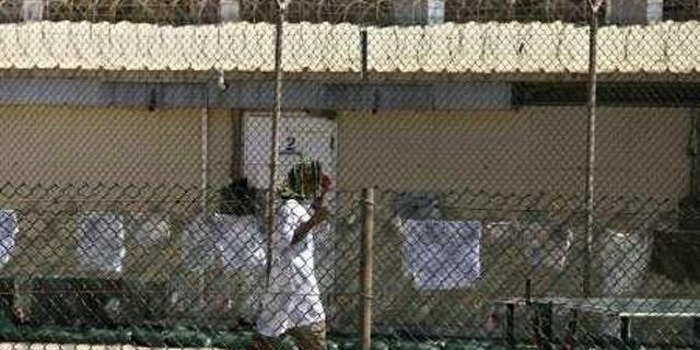 A detainee walks inside a yard at the detention facility at Guantanamo Bay May 31, 2010.