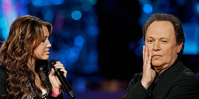 Billy Crystal is seen with Miley Cyrus on 'American Idol Gives Back.'