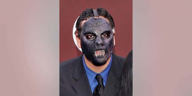 FILE - In this Feb. 13, 2005 file photo, Paul Gray from the group Slipknot arrives for the 47th Annual Grammy Awards in Los Angeles. The Iowa Supreme Court says the deceased Slipknot bassist's daughter may sue for loss of a parent's companionship, even though she was born after her father died. The ruling Friday May 6, 2016, comes in the wrongful death lawsuit that Gray's widow filed after the heavy metal bassist died of a drug overdose in May 2010. (AP Photo/Mark J. Terrill, File)