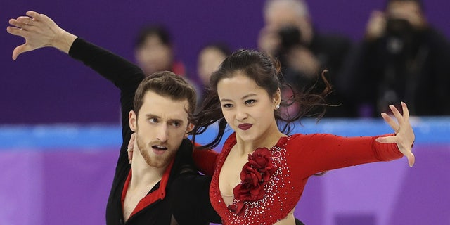 Min Yu-ra and Alexander Gamelin of South Korea compete in a performance in which her top nearly came off.