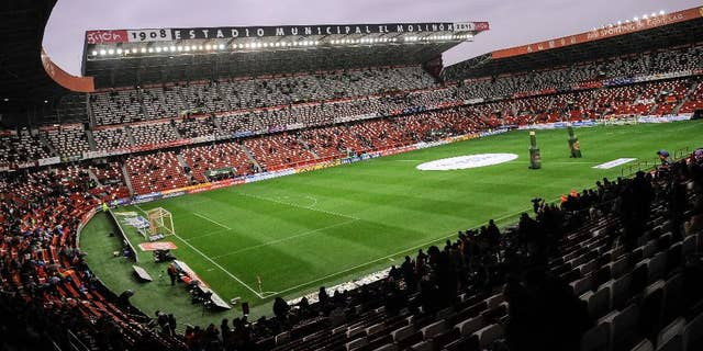FILE- In this Wednesday, Feb. 17, 2016 file photo, a general view of the El Molinon stadium during their Spanish La Liga soccer match between Sporting de Gijon and FC Barcelona, in Gijon, northern Spain. Sporting Gijon said Thursday, Nov. 17, 2016, it has been ordered to close part of its stadium during one game in the Spanish league because its fans allegedly racially insulted a player from an opposing team.  (AP Photo/Alvaro Barrientos, File)