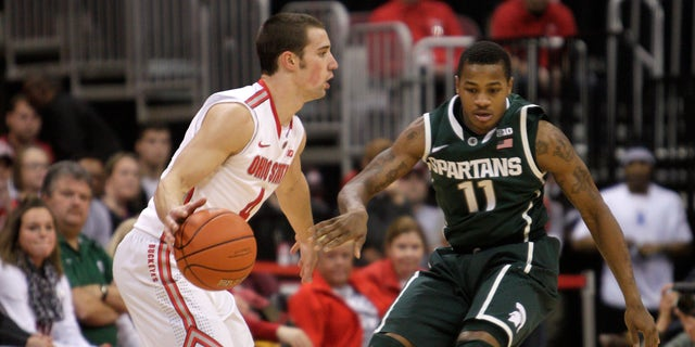 Ohio State's Aaron Craft, left, looks for an open pass as Michigan State's Keith Appling defends during the second half of an NCAA college basketball game Sunday, Feb. 24, 2013, in Columbus, Ohio. Ohio State beat Michigan State 68-60. (AP Photo/Jay LaPrete)