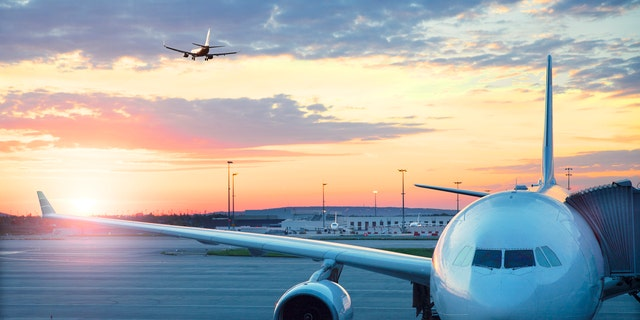 Charles De Gaulle , International airport in Paris -  Airplane at sunrise.