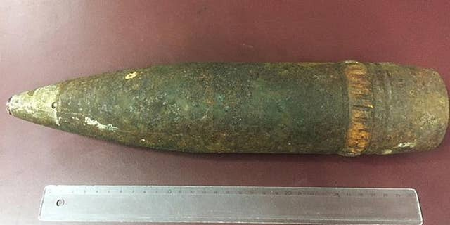 An American tourist was fined nearly $5,000 dollars after she tried to take a World War II artillery shell she found while hiking on her plane in Vienna, Austria.