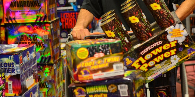 FILE - Fireworks for sale at store.