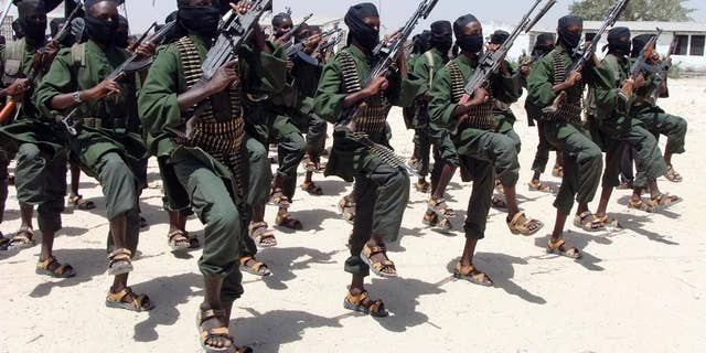 Hundreds of newly trained al-Shabab fighters perform military exercises in the Lafofe area south of Mogadishu, in Somalia.
