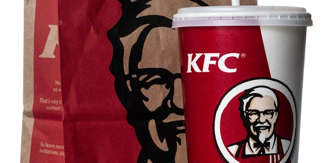 """Miami, USA - March 23, 2012: KFC soda cup with take out bag. KFC brand is owned by KFC Corporation and a subsidiary of Yum! Brands, Inc."""