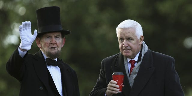 James Getty (L), portraying U.S. President Abraham Lincoln, chats with Pennsylvania Republican Governor Tom Corbett (R) before delivering the Gettysburg Address at the Gettysburg National Cemetery in Pennsylvania November 19, 2013. REUTERS/Gary Cameron