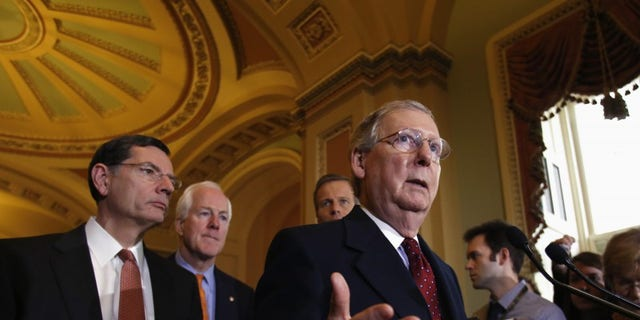 U.S. Senate Minority Leader Mitch McConnell (R-KY) speaks to the media following a Senate cloture vote on budget bill on Capitol Hill in Washington December 17, 2013. REUTERS/Yuri Gripas